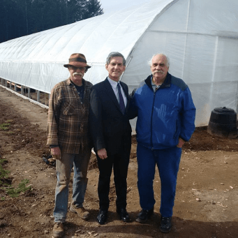 Glen with MLA Simon Gibson and Emma's Acres staff Ray King Sr